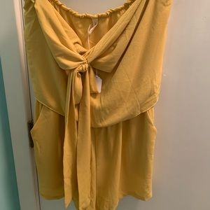 Yellow romper with tie in front and pockets